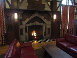 Delta Delta Chapter House Great Hall fireplace withlights