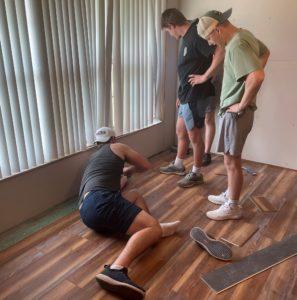 Sigs working on flooring